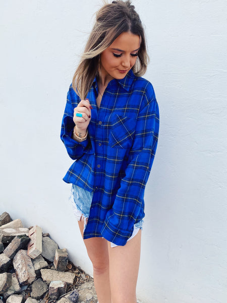 Blue Flannel Shirt by Multitudes. This Royal Blue Plaid Boyfriend Flannel is a classic! This women's blue flannel shirt is oversized, soft, and has royal, black, and a touch of yellow in the plaid. This Blue Flannel Shirt is perfect for wearing everyday! Multitudes Boutique. Cutest Online Boutique. Honeysuckle Tees.
