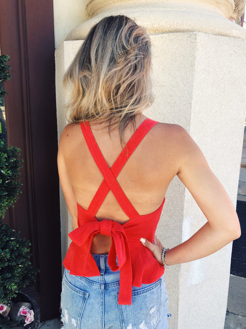 You need an Open Back Top to wear during the summer heat like this adorable Red Tie Back Peplum Top! This Backless top is perfect to wear to your Fourth of July celebration! Pair it with your favorite distressed denim shorts and white sneakers and you'll be decked out in all the right colors! Multitudes Boutique.