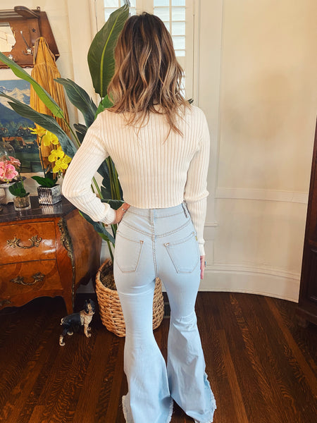 White Crop Sweater at Multitudes Boutique - The Wilson Long Sleeve Cropped Sweater is a perfect basic this season! This Cropped V Neck Sweater is ribbed and fitted. This White Long Sleeve Crop Top is perfect to wear with your High Waisted Jeans, Skirts, and Shorts! Multitudes Boutique. Cutest Online Clothing Store.
