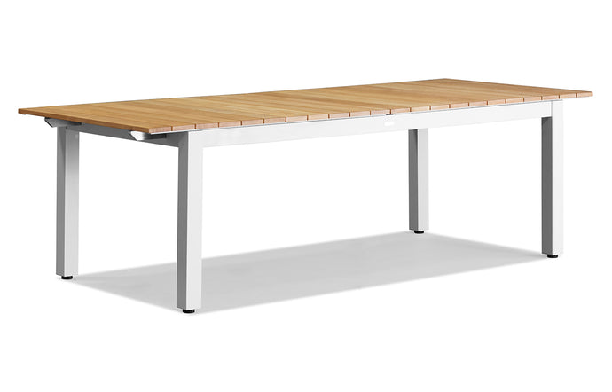 Pacific Extendable Aluminum Dining Table by Harbour - White Aluminum + Natural Teak Wood.