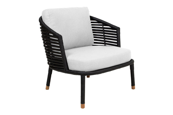 Sense Indoor Lounge Chair by Cane-Line - Black Rattan Frame, White Natte Cushion Set.