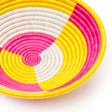 neon yellow and pink straw basket at maeree