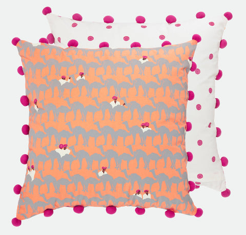 Liven up a neutral colour scheme with Safomasi's quirky pink and orange Camel Traders cushion by Safomasi. The unique design features the camel traders' bright turbans popping up from within a sea of camels. This stylish cushion with its bright pink pom poms will add colourful accents and fun to your home.