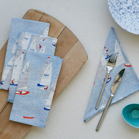 Give your tableware a nautical makeover with these fun hand printed cotton linen Regatta napkins. Inspired by Salcombe's Regatta, the napkins features racing yachts. They make a great addition to nautical-inspired home decor or a fun gift.