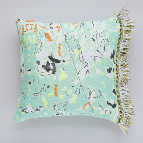 Add texture and colour to your home decor with Roos Soetekouw's Fun Green Fringe cushion featuring a marble pattern inspired by the shapes and patterns found inside a mattress. The unusual cushion design comes to life in a textured fabric blend complemented with a vibrant fringe. Perfect for livening up neutral living spaces.