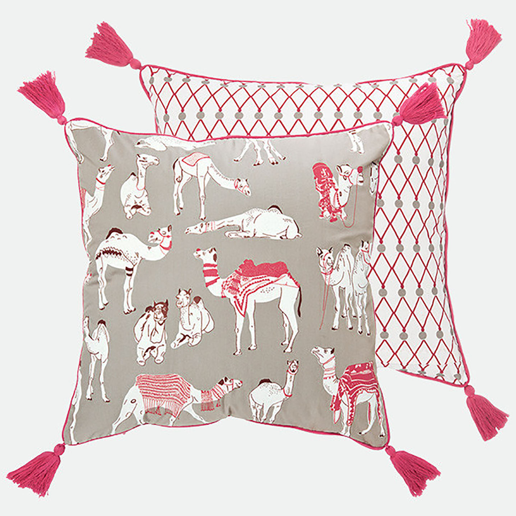 In a beautiful soft grey and red colour palette, the Different Camels cushion by Safomasi is inspired by the festive Pushkar Camel Fair. Adorning the hand printed cushion is a decorative print of camels dressed in ornate jewellery and fancy coats. The gorgeous camel pattern and red tassels are ideal for a sofa or bedroom.