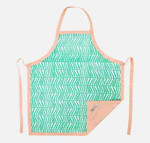 In a tropical mint palm print design, the stylish cotton hand printed apron makes a wonderful gift for the chef or foodie in your life.