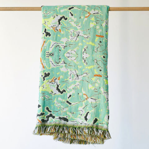 Add texture and colour to your home decor with Roos Soetekouw's Fun Green throw featuring a marble pattern inspired by the shapes and patterns found inside a mattress. This stylish throw design comes to life in a textured fabric blend complemented with a vibrant fringe.