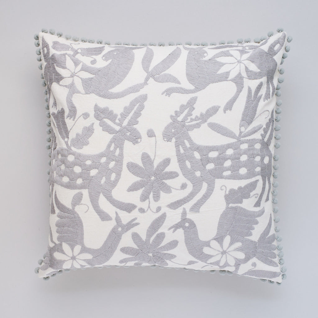 Grey Otomi cushion by Yucu Ninu