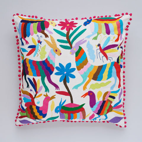 Add texture to your home decor and embrace colour with this vibrant Otomi cushion by Yucu Ninu. Collaborating with Mexican artisans, the traditional design features hand embroidered flowers and animals with an on trend pom pom edging. This stylish cushion will add a colour injection to your home and is a perfect  throw cushion for your sofa or bedroom.