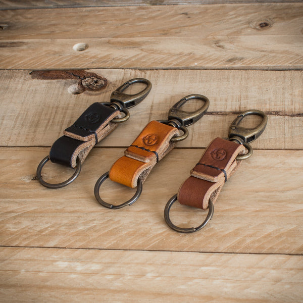 Image showing groomsmen gift - a set of three oak bark leather keychains from Colville Leather