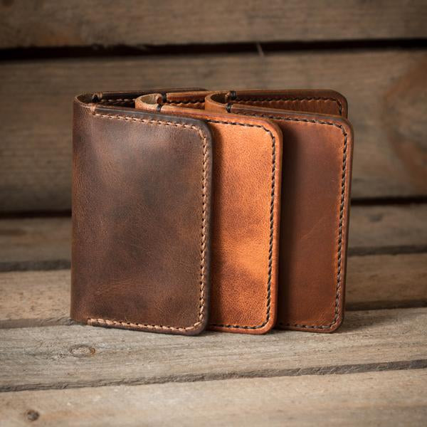 Image of three handmade leather wallets from Colville Leather