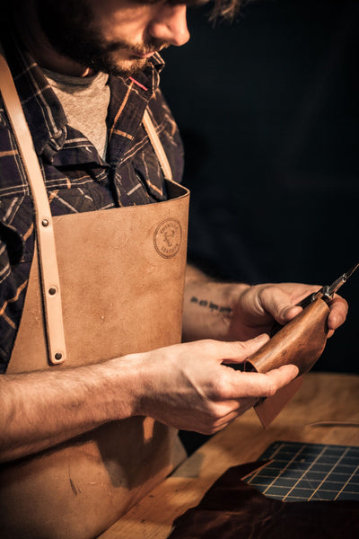 Image of Matt Nesbitt from Colville Leather handcrafting a leather wallet