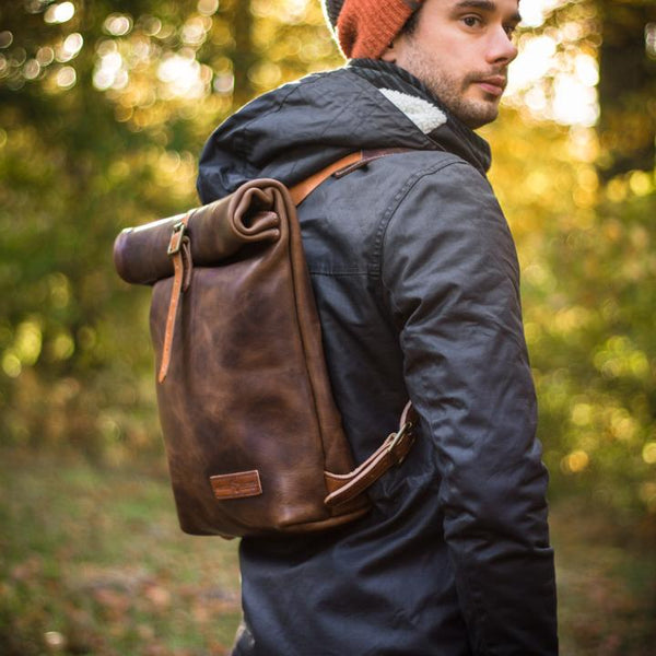 Matt Nesbitt wears leather roll-top backpack from Colville Leather