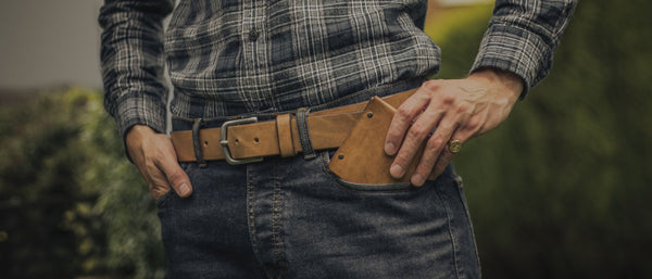 image showing a man wearing a Colville leather handcrafted belt with matching colour wallet in his pocket