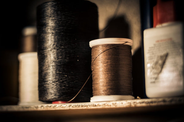 image of two reels of rot resistant thread used by Colville Leather in their handmade leather accessories