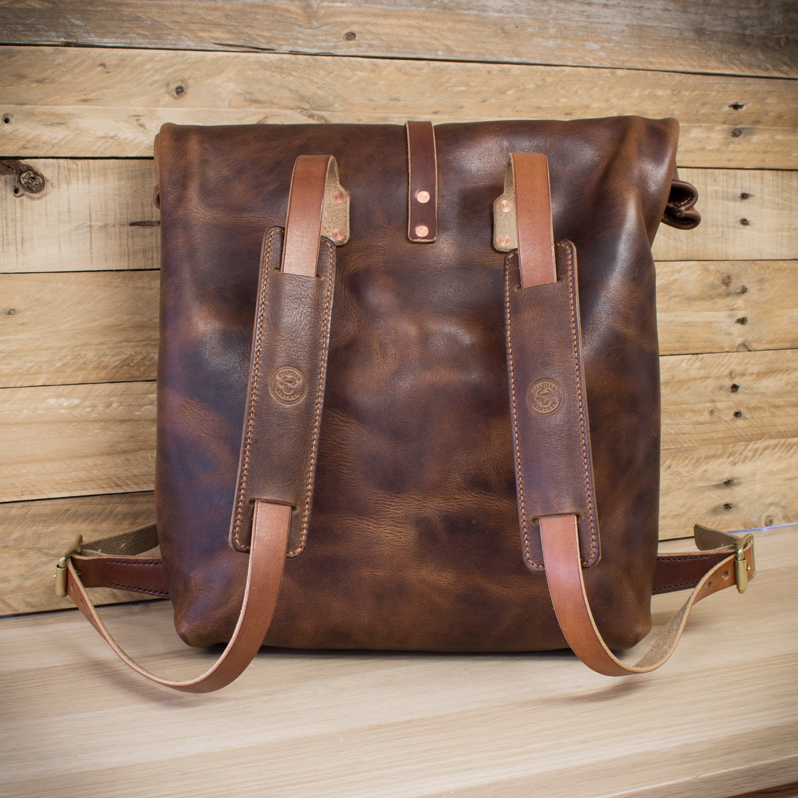 The back of Colville Leather's handmade roll top backpack