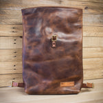 Unrolled image of Colville leather roll top backpack made with solid brass and copper hardware