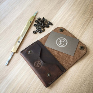Leather knife next to a handmade leather wallet
