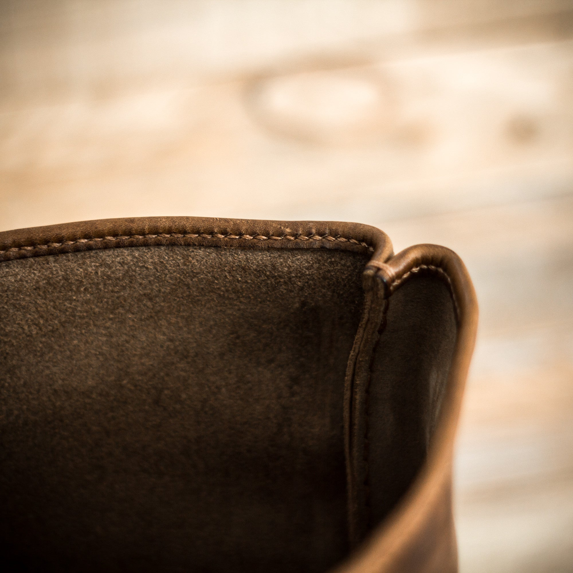 Hand stitching detail of Colville Leathers roll top backpack