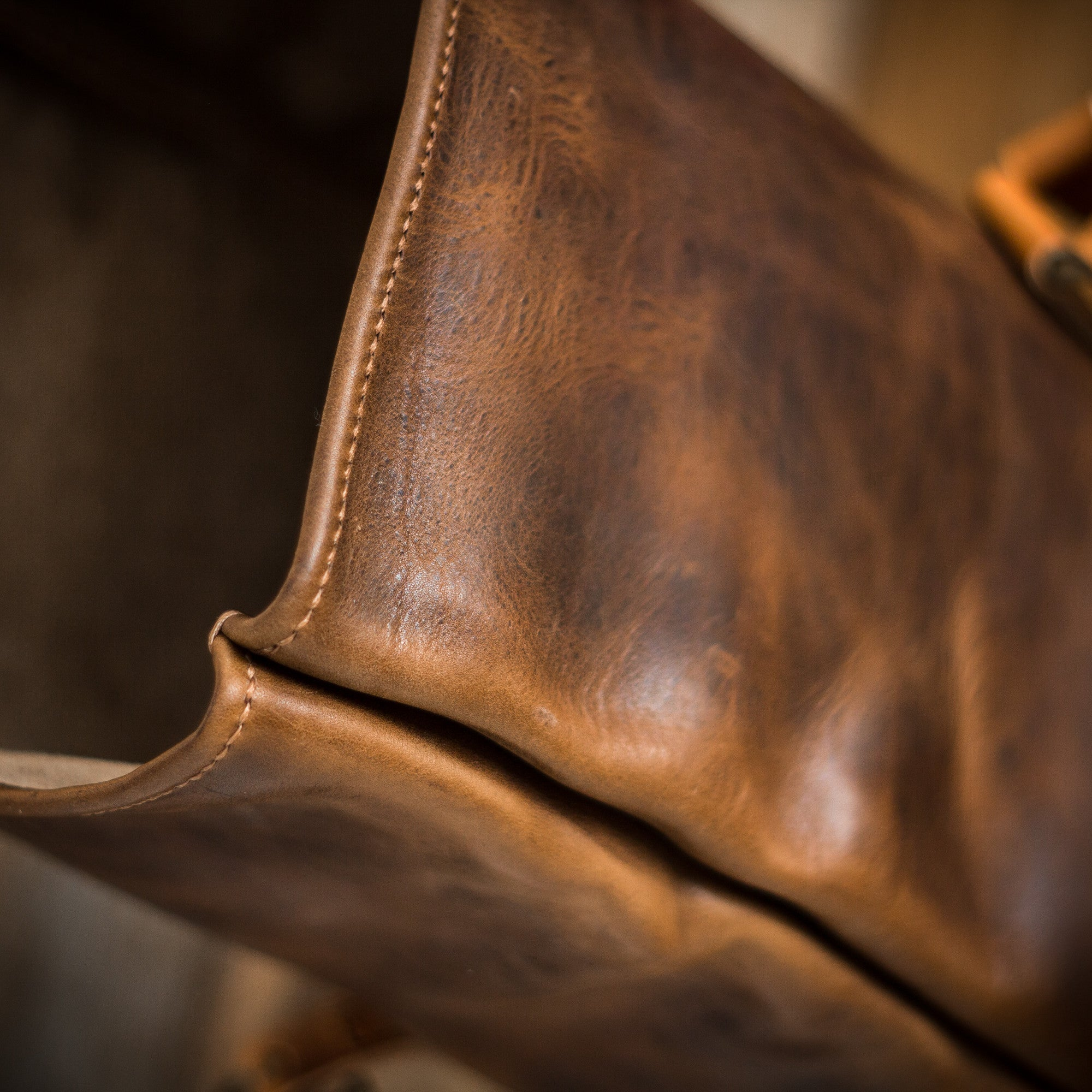 Side shot of the handmade roll top backpack by Colville Leather