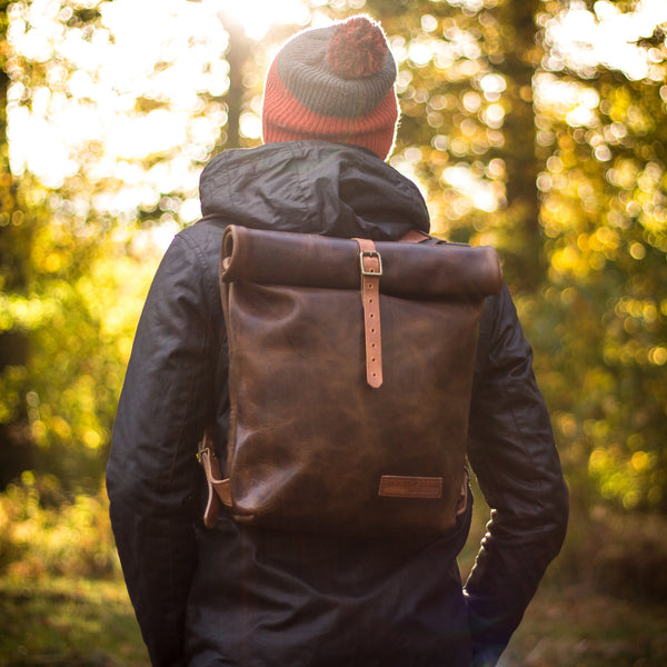 ethical leather bag on man in woods