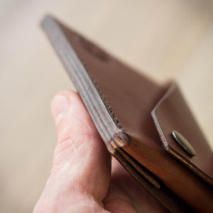 Burnished edges on handmade leather wallet