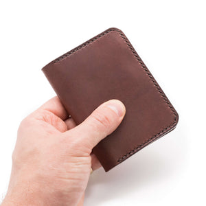 Hand holding bifold leather wallet