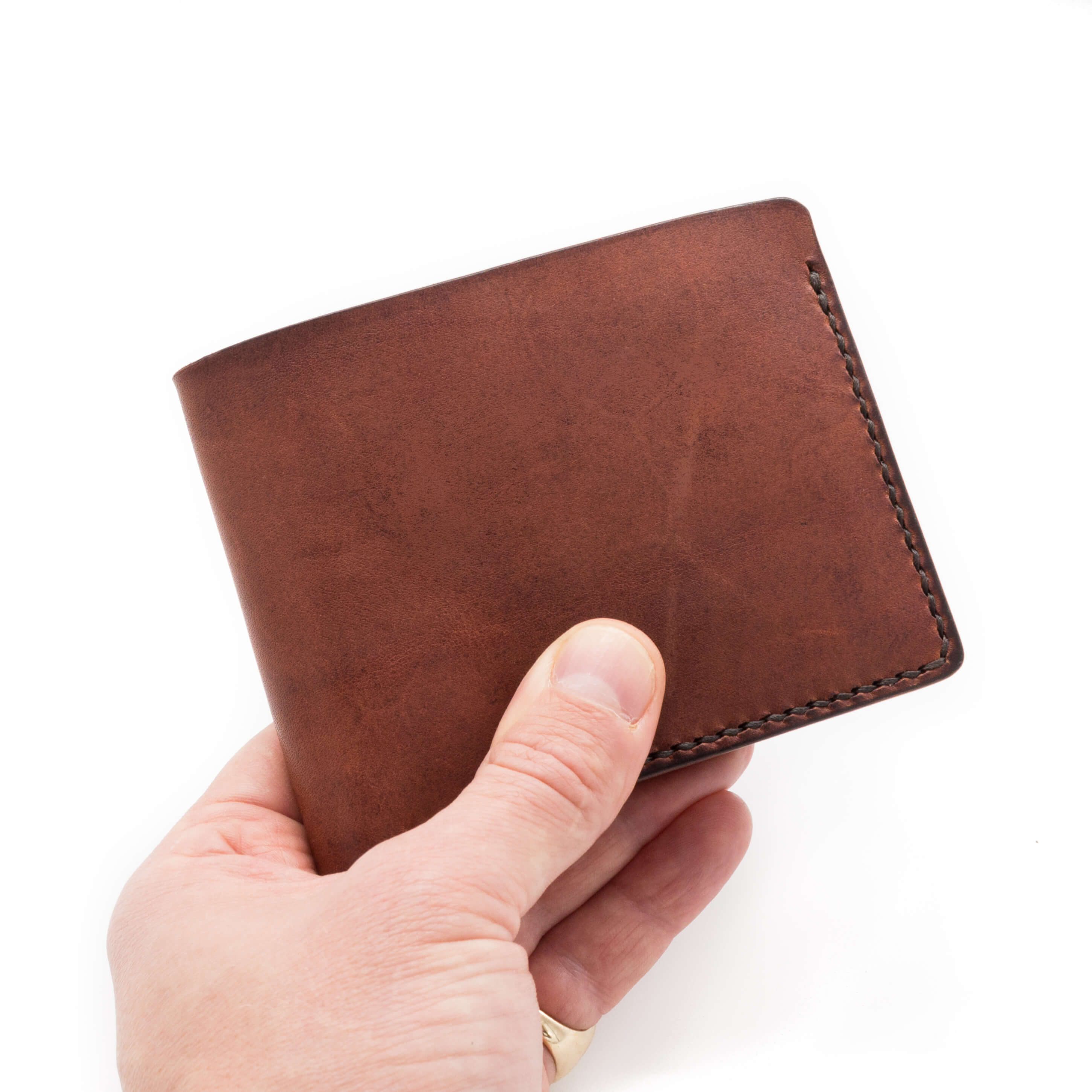 Hand holding handmade leather wallet