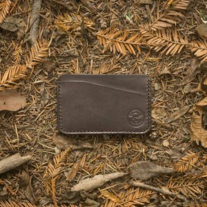 leather wallet in the woods