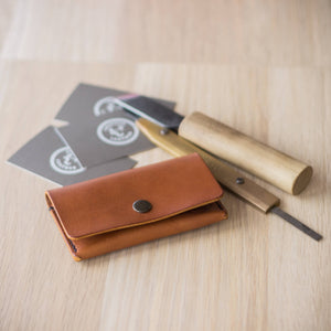 leather knifes next to leather business card holder