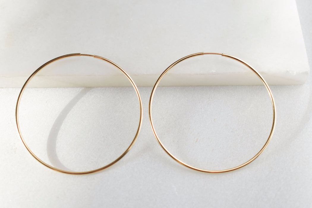 Large gold-filled hoop earrings. Effortless endless oversized hoops.