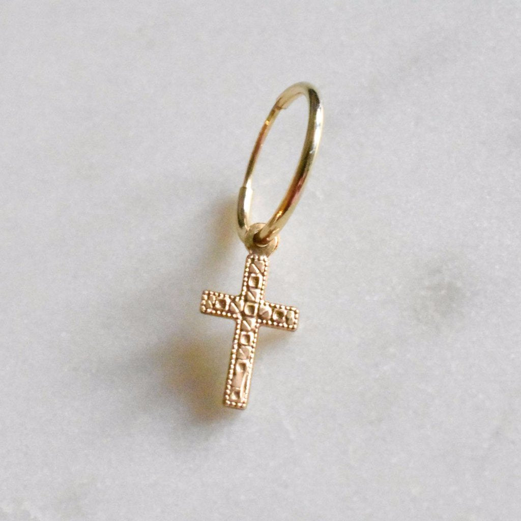 14k gold-filled cross huggie hoop is cute and dainty.