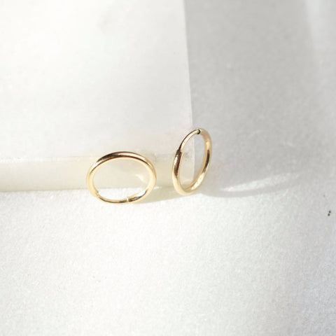 Gold-filled huggie endless hoop. Minimal, lightweight small 12mm gold hoops.