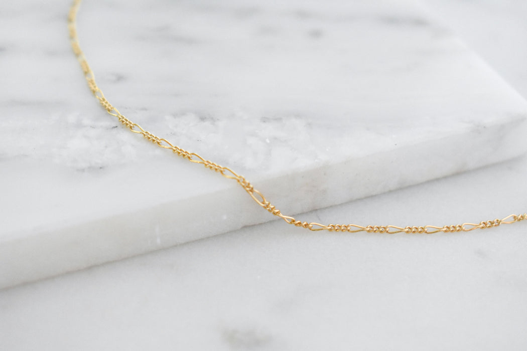 Gold minimal choker meant for layering with lariats and long necklaces.