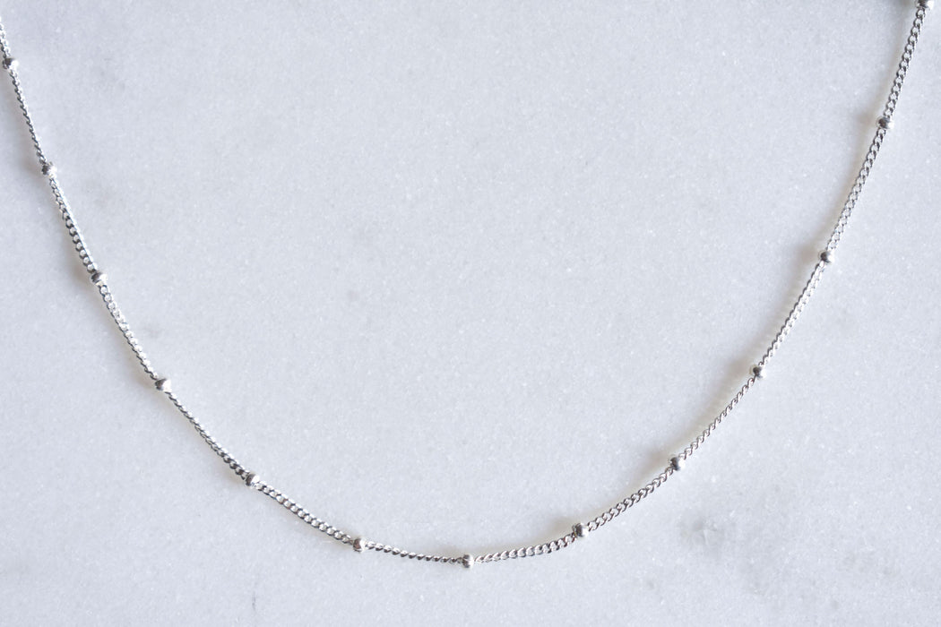 Delicate Satellite silver choker for layering.