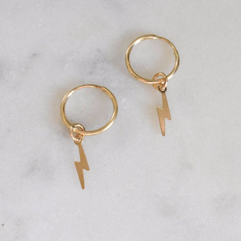 Tiny little gold hoops are perfect for everyday. Little hoops for the ultimate ear party.