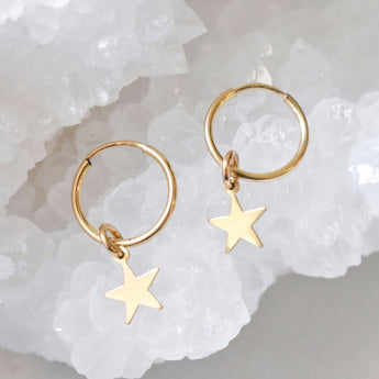 Star Huggie Hoops Gold filled. These hoops are minimal and delicate.