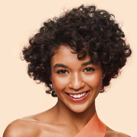 Curly Hair model after using shampoo and conditioner with papaya enzymes.