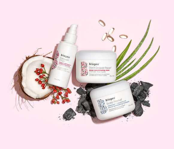 Briogeo products pictured with ingredients including coconut, aloe, and charcoal