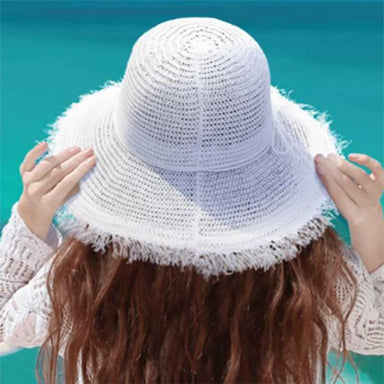 "Crocheted White Straw Summer Hat - Sun'N'Sand® Hats  https://setartrading.com/products/crocheted-white-straw-summer-hat-sunnsand-hats  This new style for 2021& brings vibes of the hippie crochet hats of the 1960's. Wide brim summer hat with frayed edge brim. Brim is 4"" wide, shapeable. Faux suede tie with bow. Inner drawstring to adjust size. Packable crushable hat"