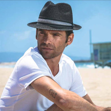 Model wearing Jericho black straw fedora by brooklyn hat co.