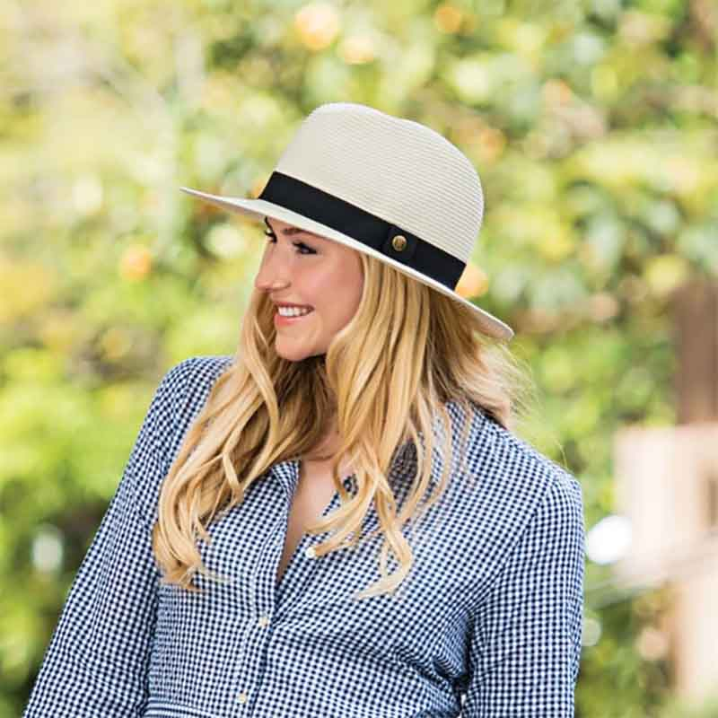 The perfect unisex resort hat to match any wardrobe coordination. women wearing ivory color palm beach hat