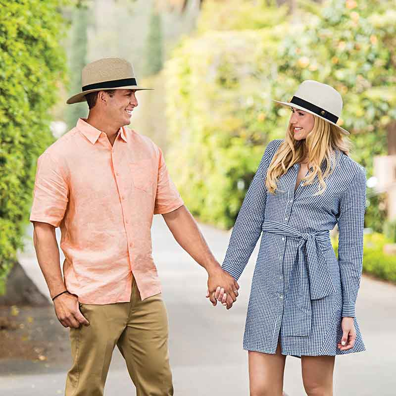 The perfect unisex resort hat to match any wardrobe coordination. Men and women model wearing wallaroo palm beach ivory and beige hat