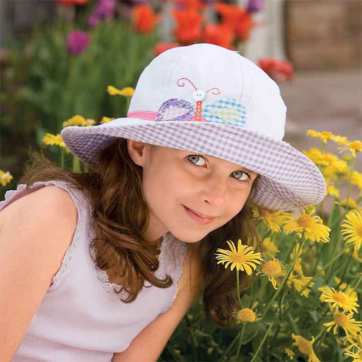 "Colorful sun protective hats for girls. Soft cotton 6 panel hat with lined crown.   Crown size is 54 cm (21.25""); fits ages 4-8 years.  Embroidered whimsical applique detail.  Matching contrast pattern underbrim.  3"" wide shapeable brim.  Wallaroo Kids tab on side.  Packable, crushable.  Rated for excellent UPF 50+ sun protection."