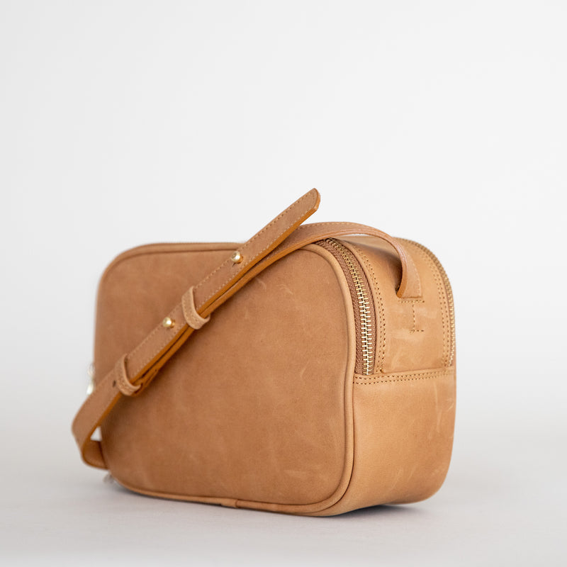 Cruz crossbody in aged tan from side
