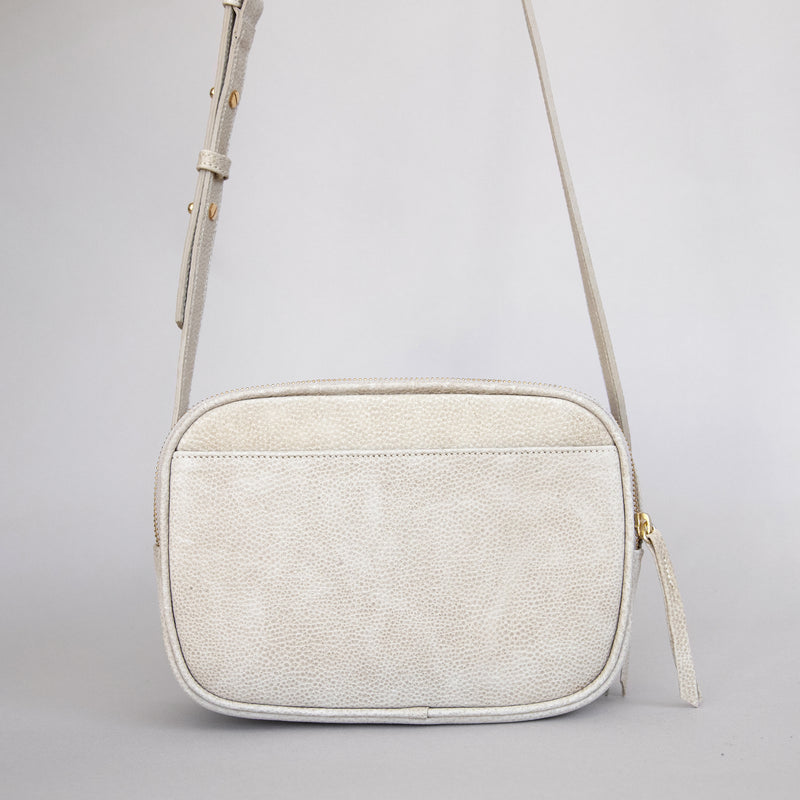 Cruz crossbody in latte from back