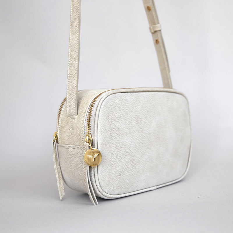 Cruz crossbody in latte from side