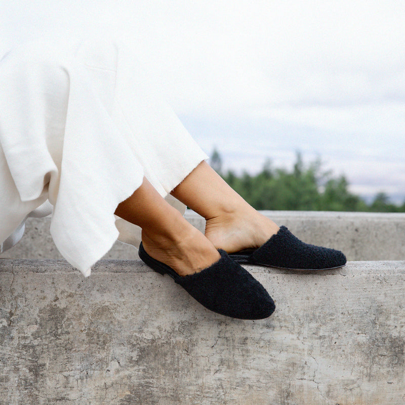 Catalina mules in black on model