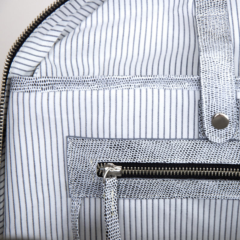 Gaucho backpack in Komodo Grey internal pocket hardware